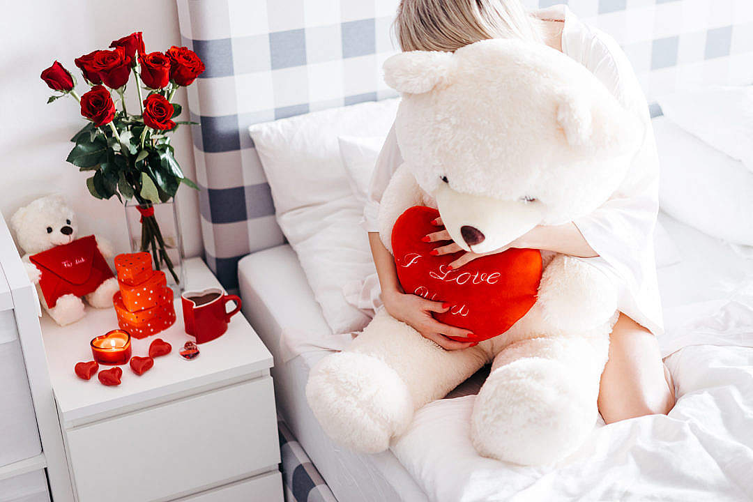 Download Woman Hugging Big Teddy Bear FREE Stock Photo