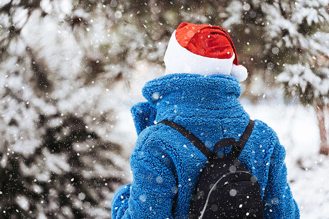 Download Woman in a Christmas Santa Claus Hat FREE Stock Photo