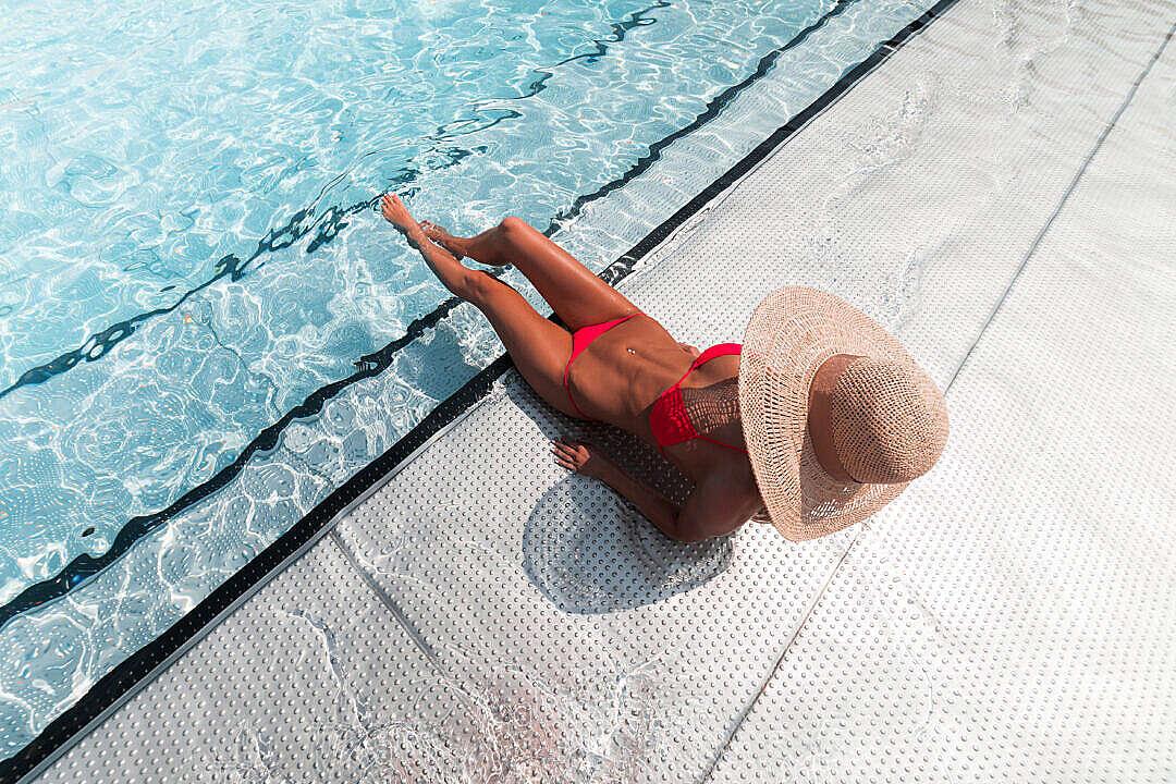 Download Woman in Bikini Sunbathing at The Pool FREE Stock Photo