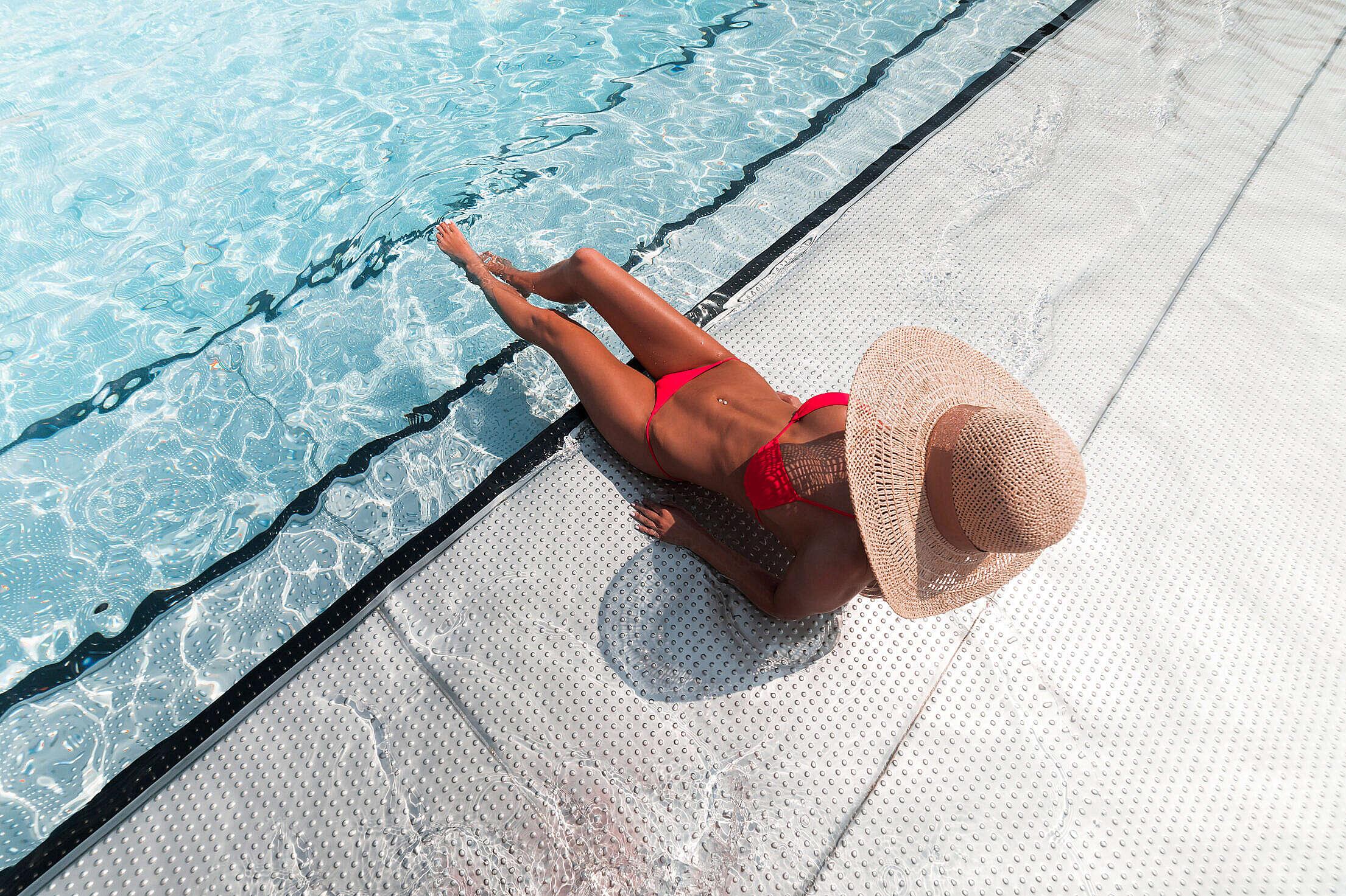Woman in Bikini Sunbathing at The Pool Free Stock Photo