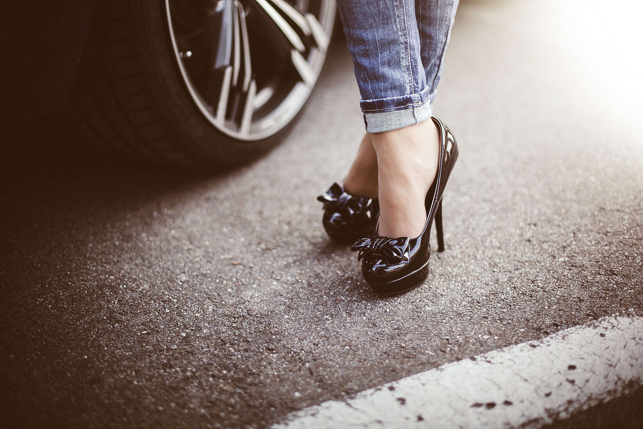 Woman in Black High Heels Standing Next to a Car #2 Free Stock Photo