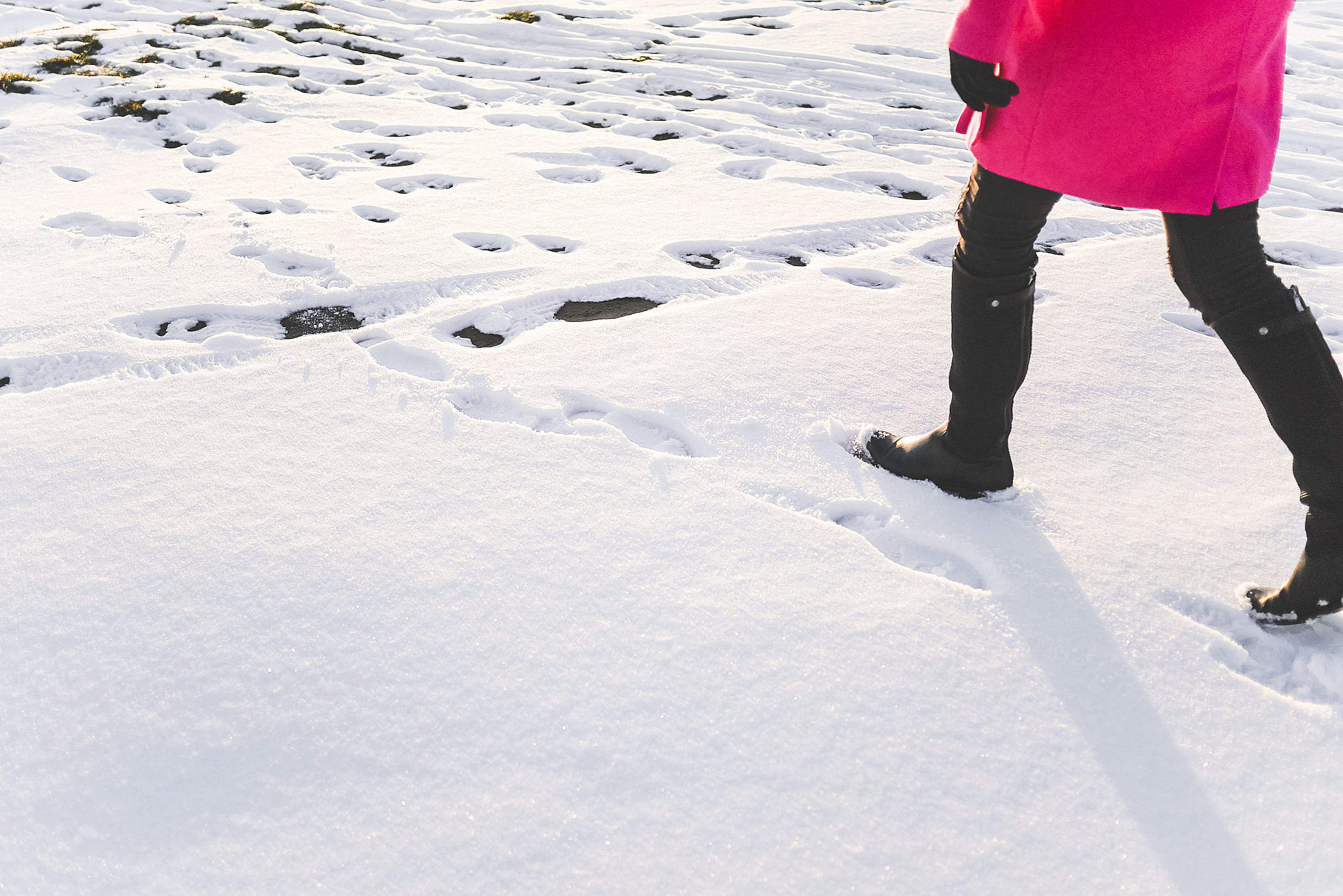Woman in Black Knee High Boots Walking in Snow Free Stock Photo
