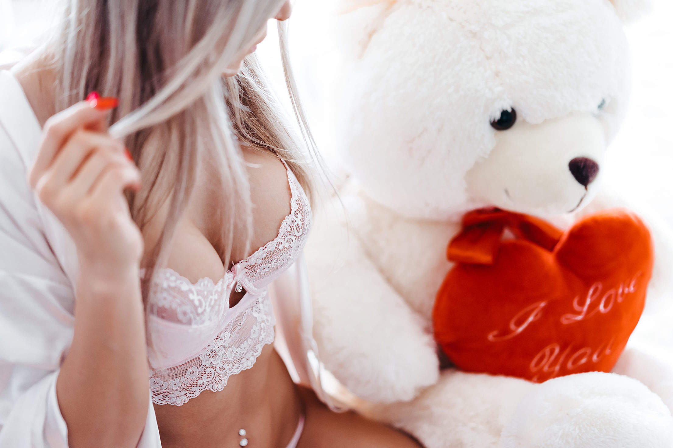 Woman in Pink Lace Lingerie with Big White Teddy Bear Free Stock Photo