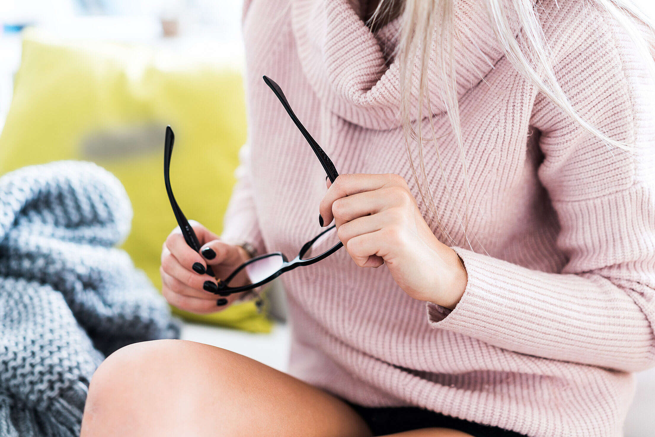 Woman in Pink Sweater Holding Glasses Free Stock Photo