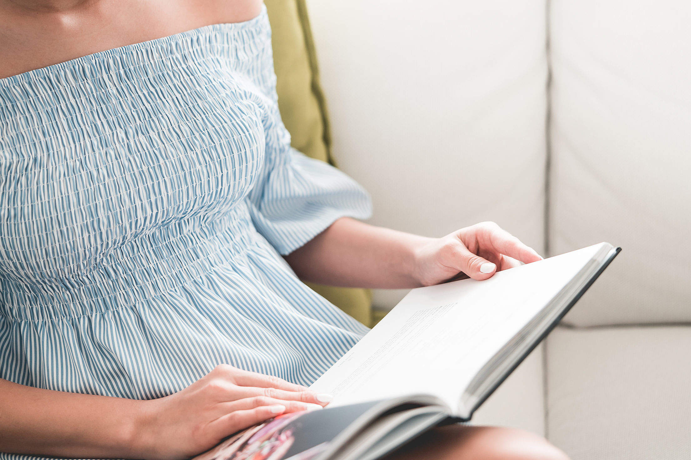 Woman in Summer Dress Reading a Book Free Stock Photo