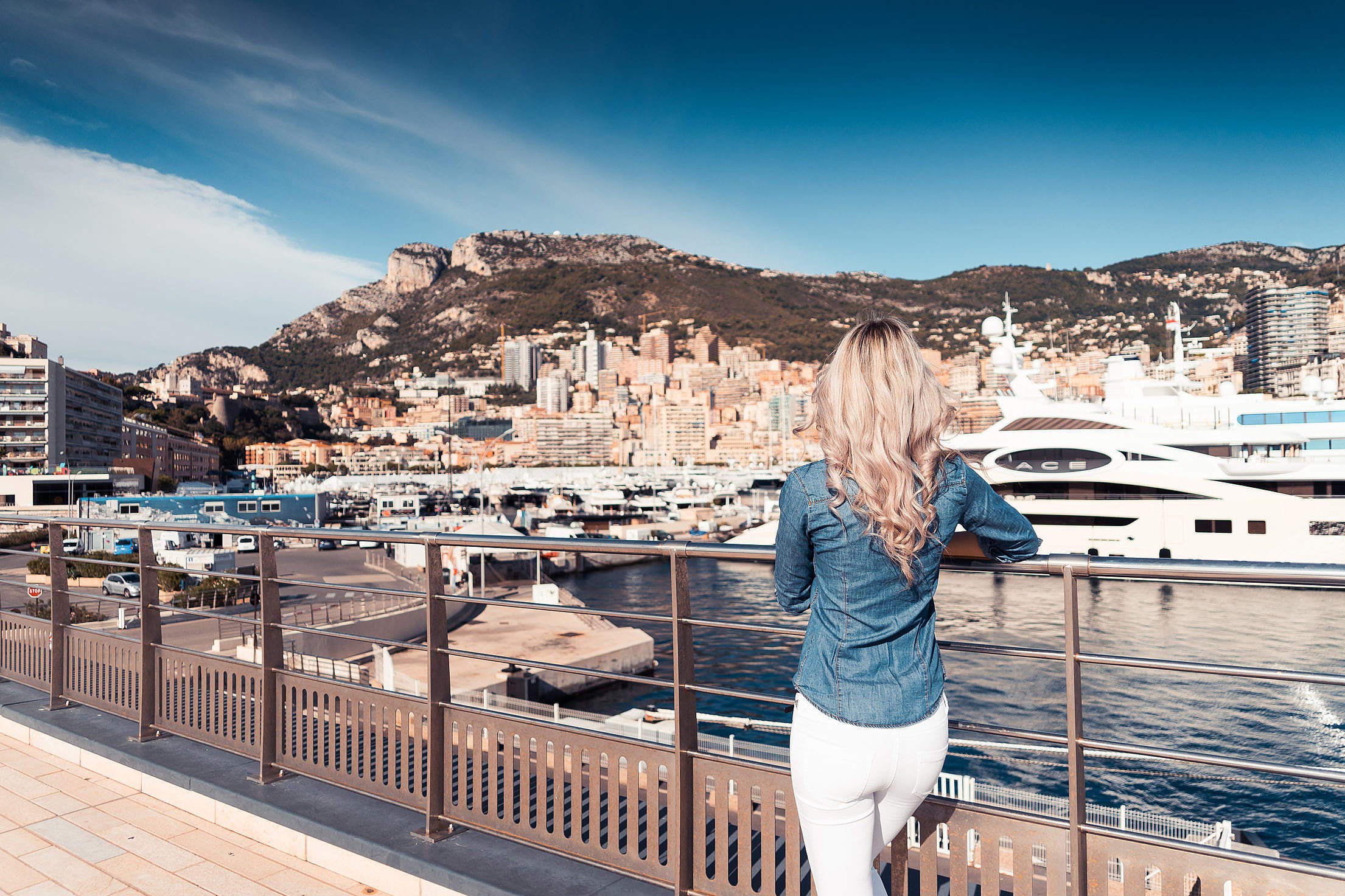 Download Woman Looking at Boats in Port of Monaco Harbor Free Stock Photo