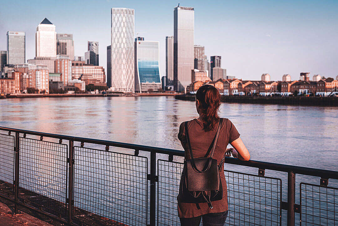 Download Woman Looking at Canary Wharf Business District Skyscrapers FREE Stock Photo