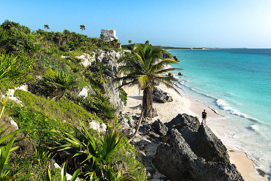 Download Woman on a Beach near Ruins in Tulum Mexico FREE Stock Photo