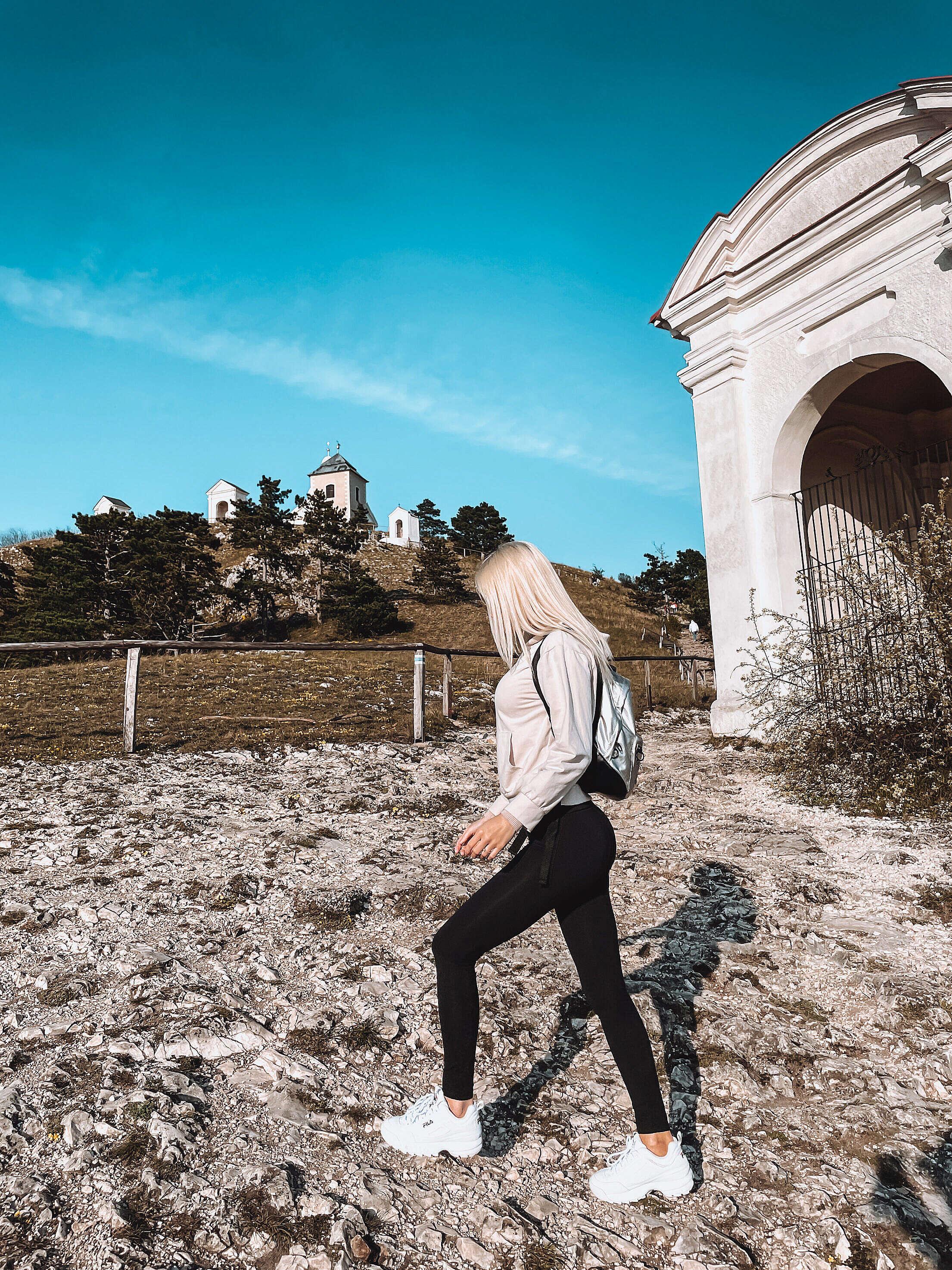 Woman on a Walk to Svaty Kopecek in Mikulov, Czechia Free Stock Photo
