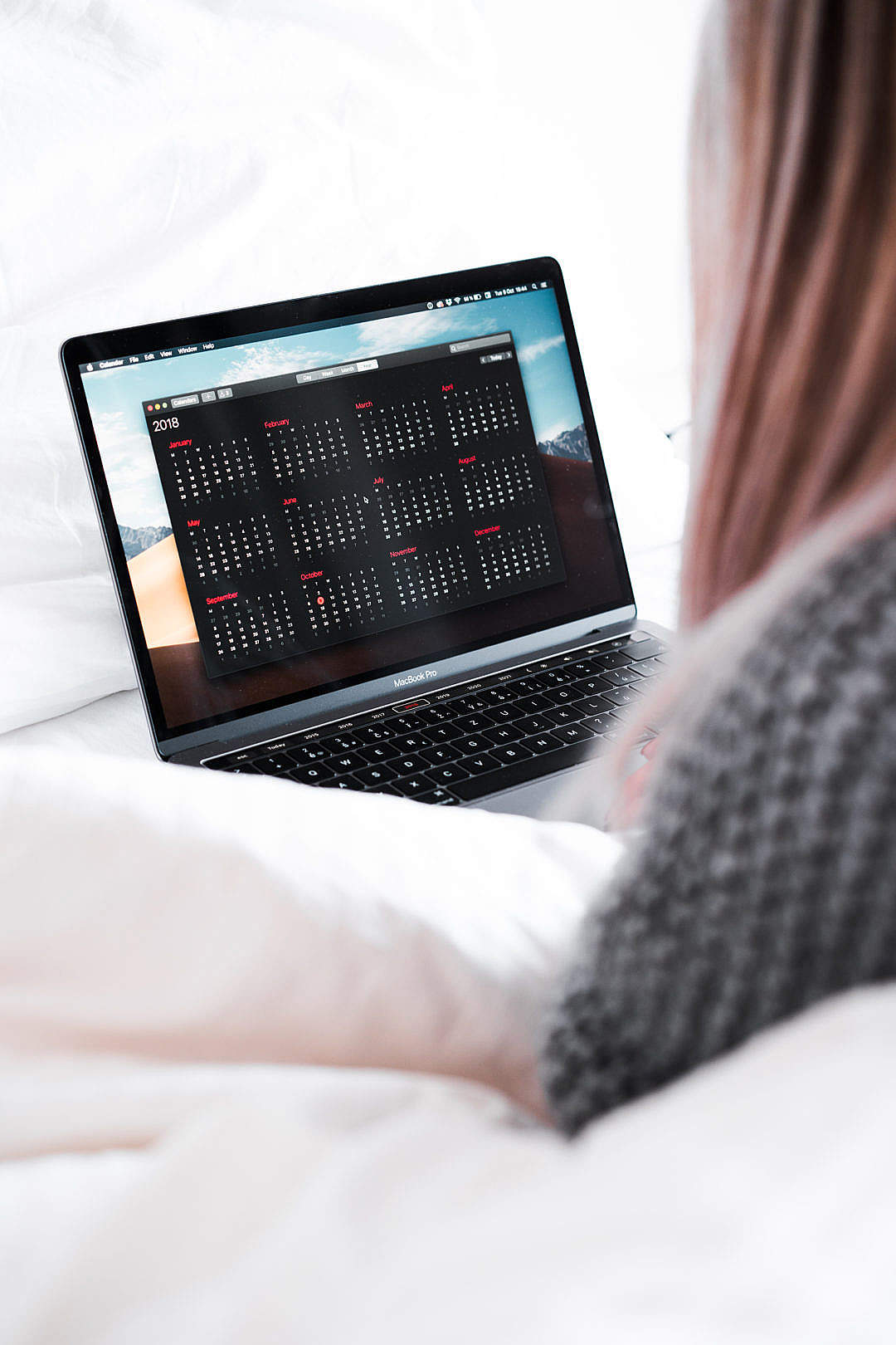 Download Woman Planning Her Calendar in Bed FREE Stock Photo