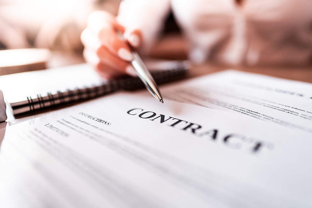 Download Woman Pointing at Business Contract with Silver Pen FREE Stock Photo
