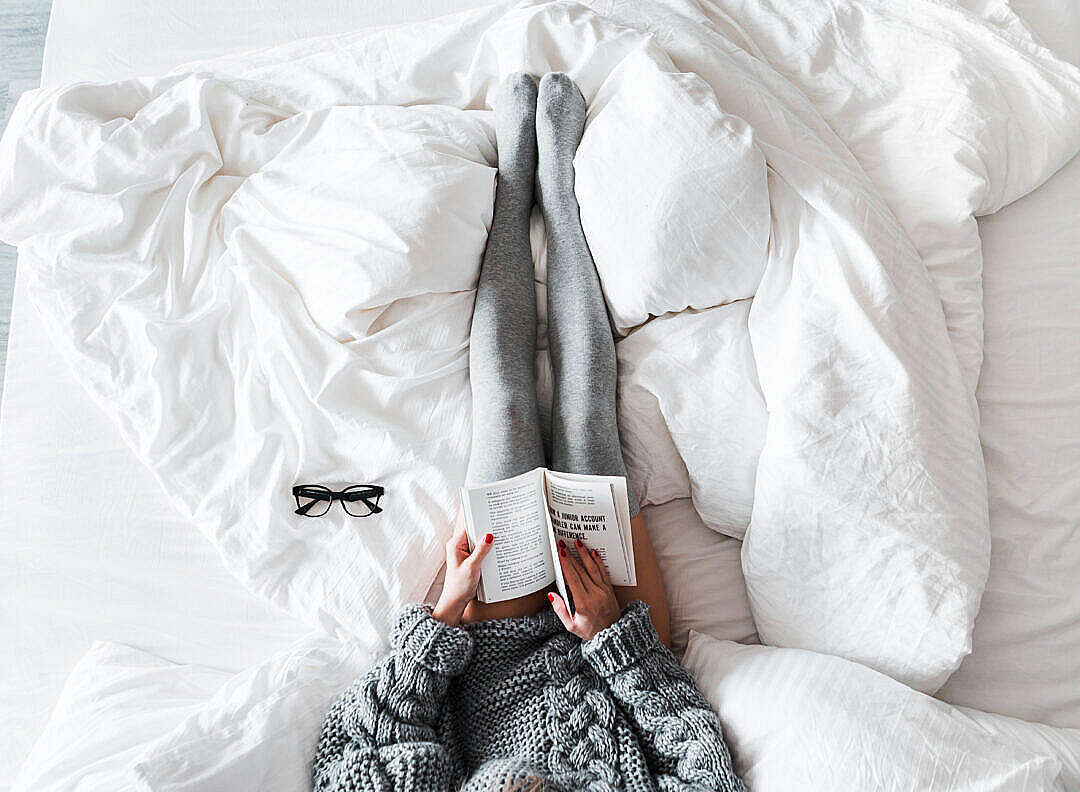 Download Woman Reading a Book in Bed FREE Stock Photo