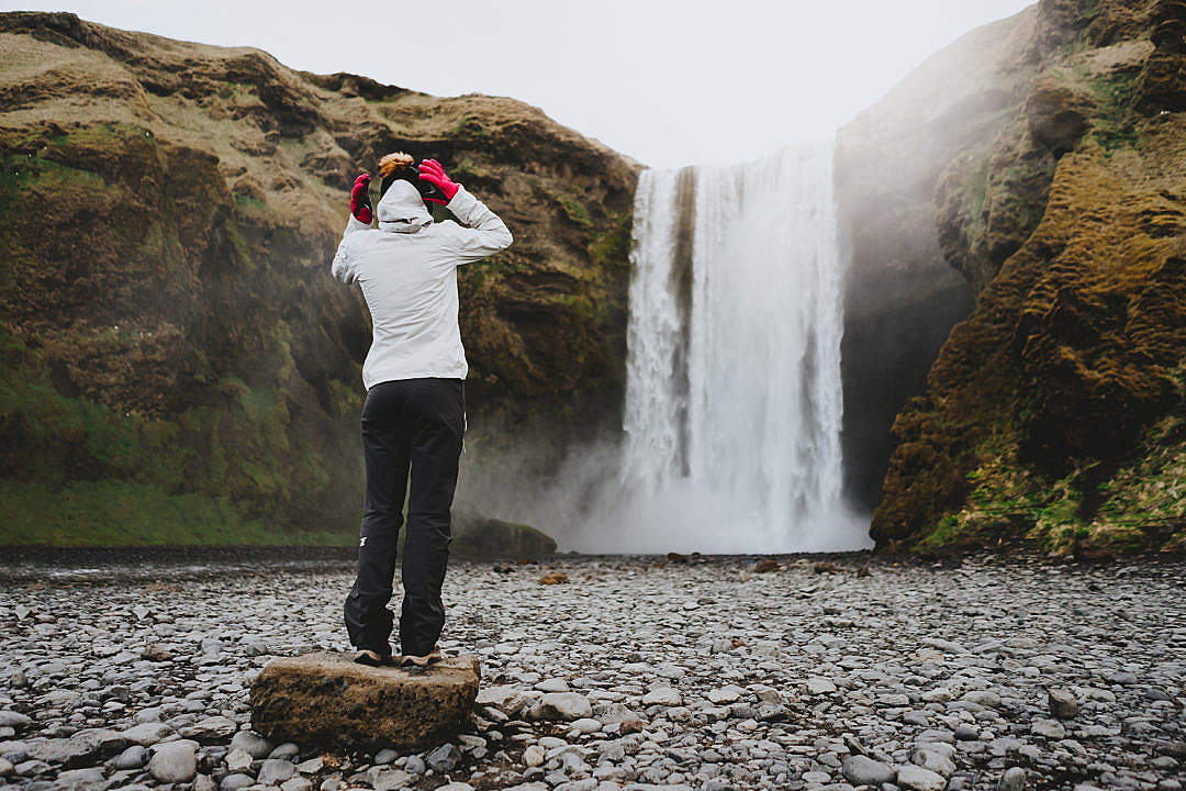 Download Woman Standing at Skógafoss Waterfall FREE Stock Photo