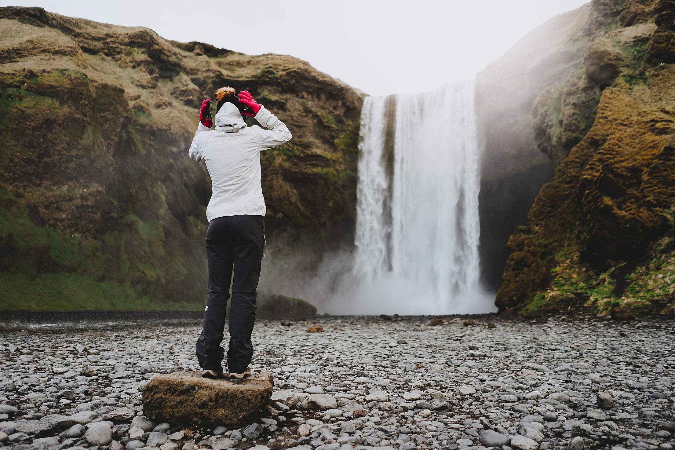 Woman Standing at Skógafoss Waterfall Free Stock Photo