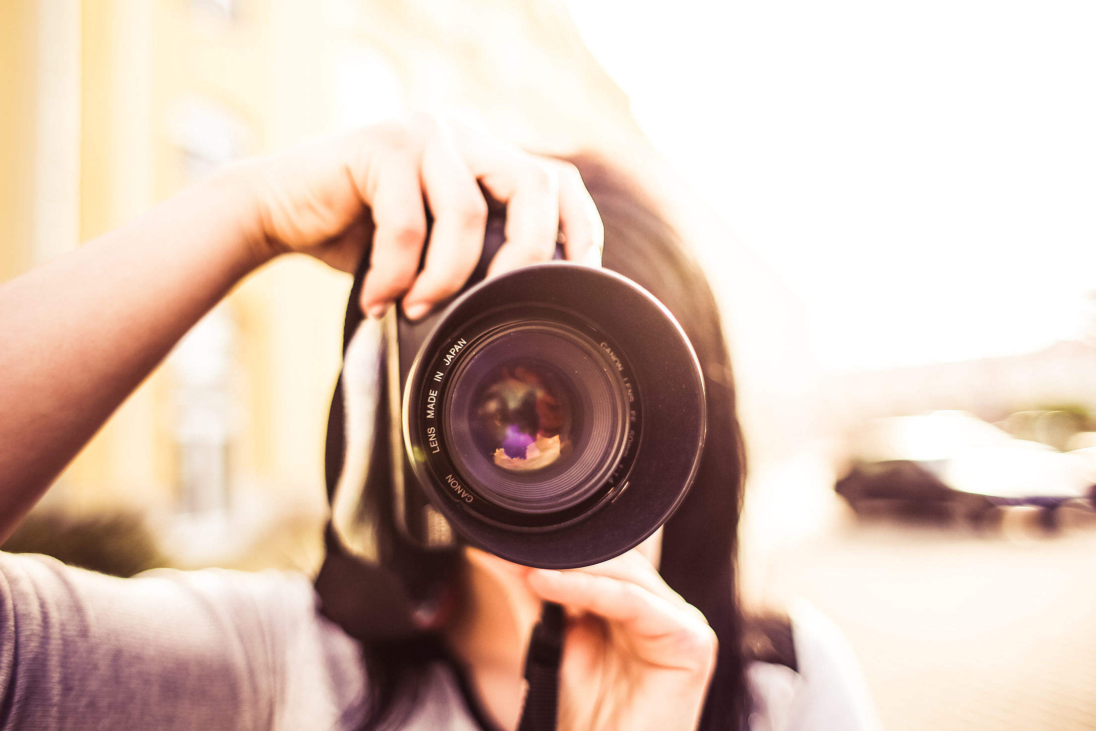 Woman Taking a Photo with DSLR Free Stock Photo