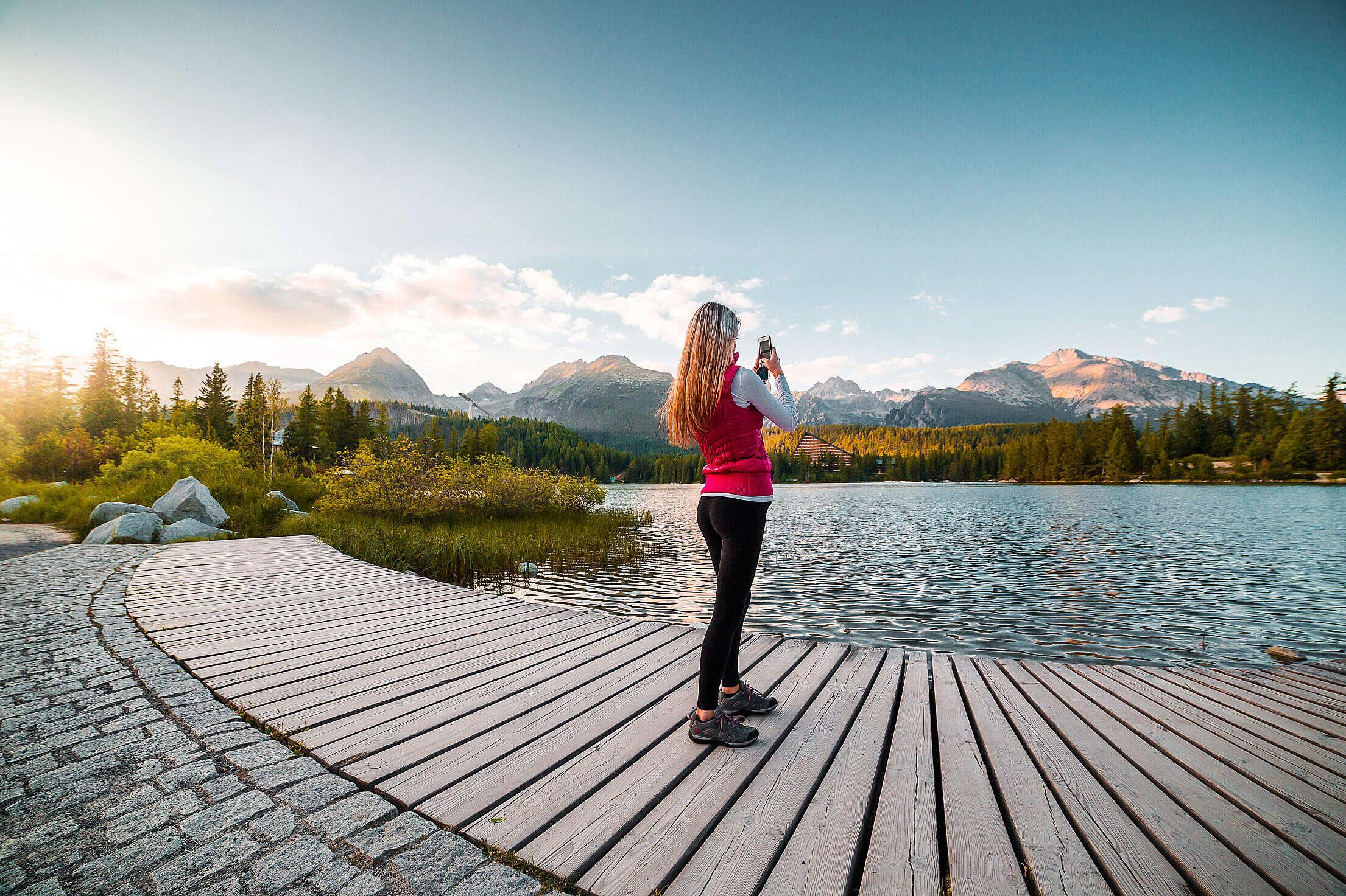Woman Traveler Taking a Photo of Tremendous High Tatras, Slovakia Free Stock Photo