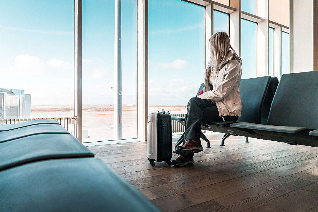 Download Woman Traveler Waiting at Icelandic Airport FREE Stock Photo