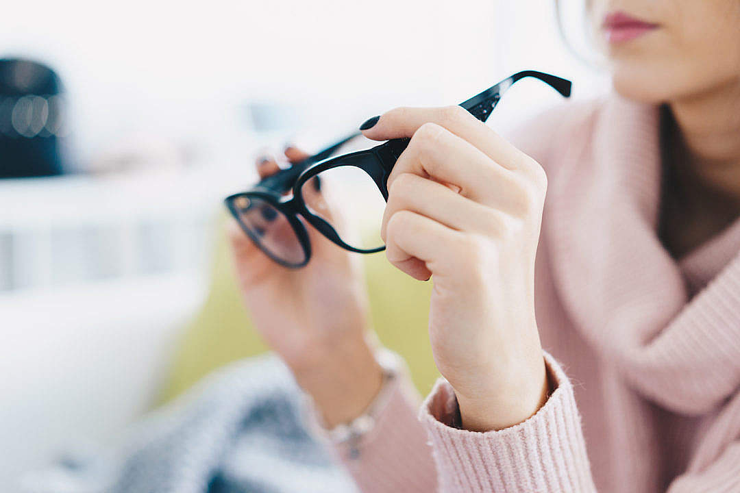 Download Woman Trying Eyeglasses in Optical Store FREE Stock Photo