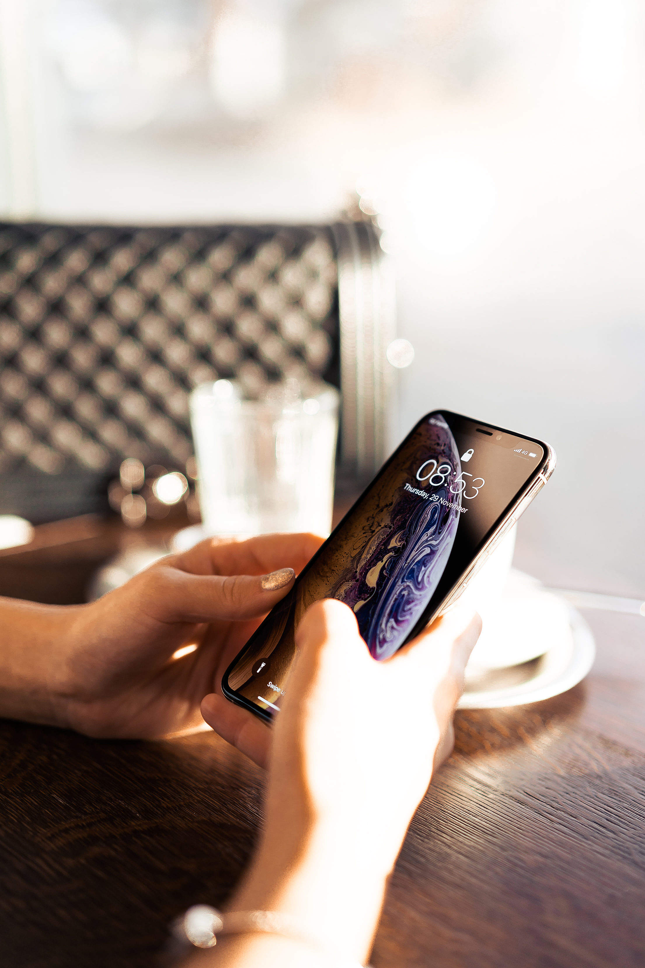 Woman Using a Modern Smartphone in Café Free Stock Photo