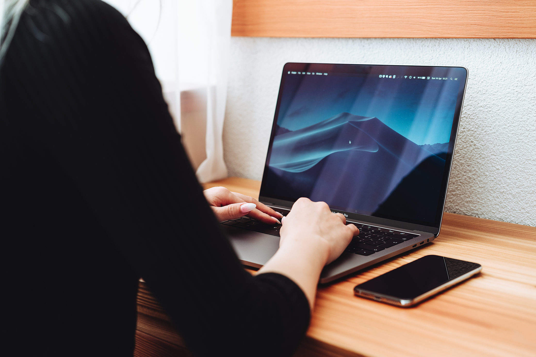 Woman Using a New Laptop Free Stock Photo