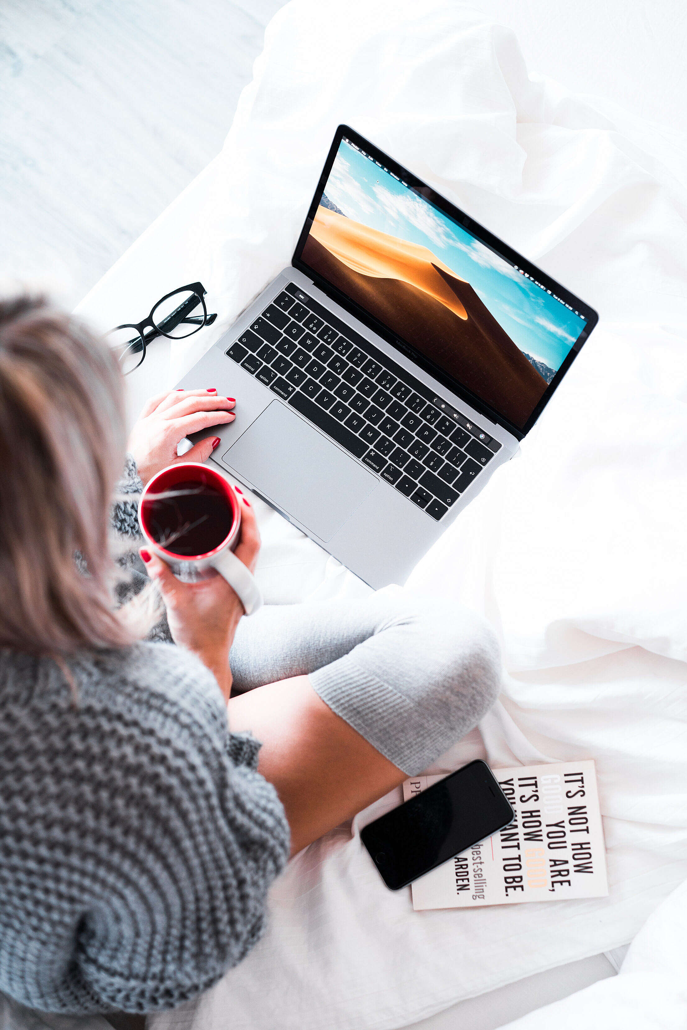 Woman Using Her Laptop in Bed Free Stock Photo