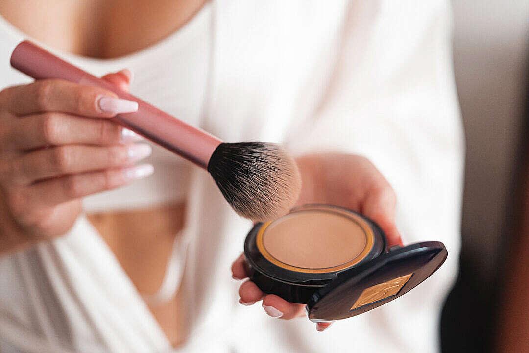 Download Woman Using Make Up Powder Brush FREE Stock Photo