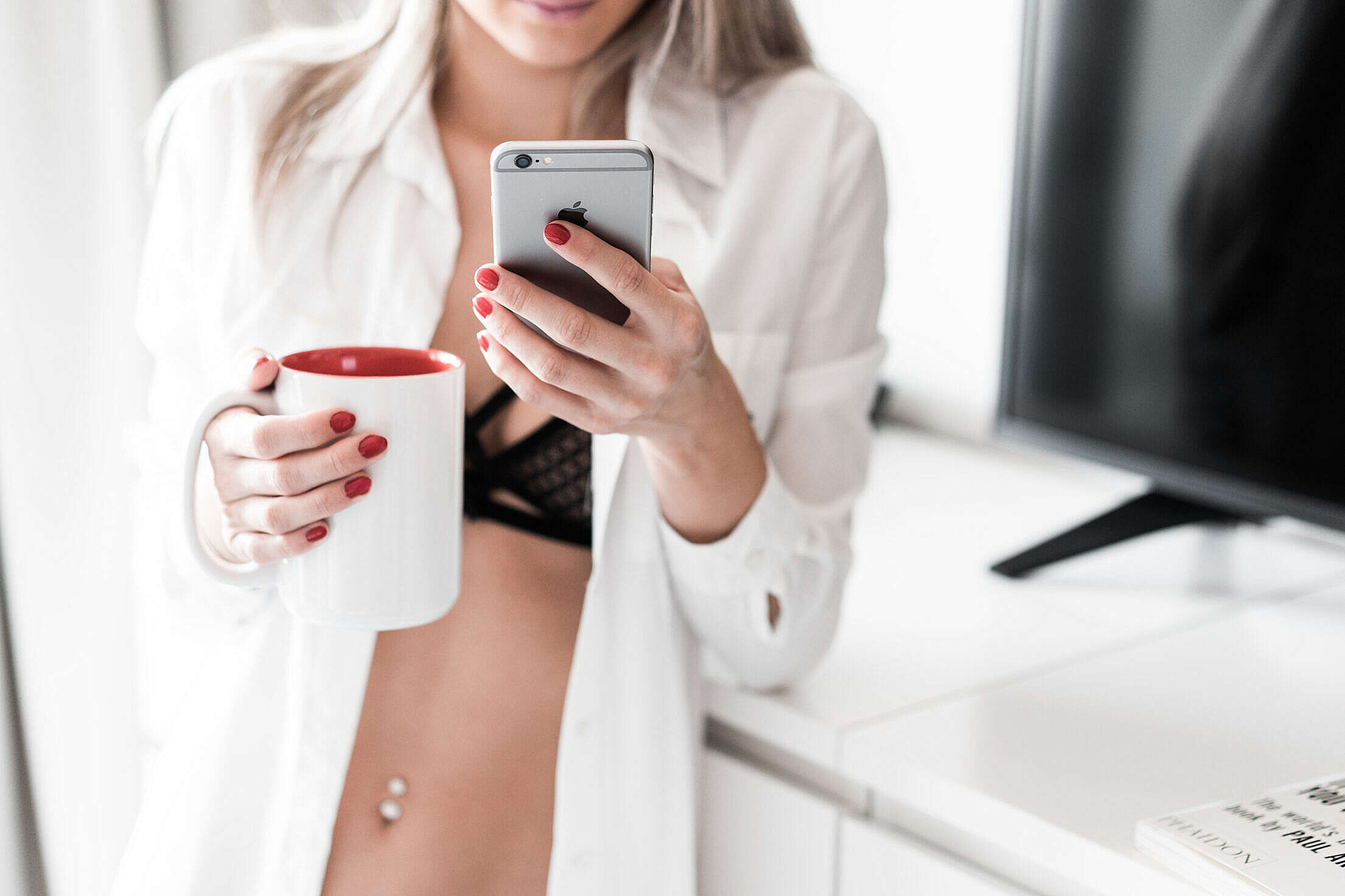 Woman Using Smartphone at Home Free Stock Photo