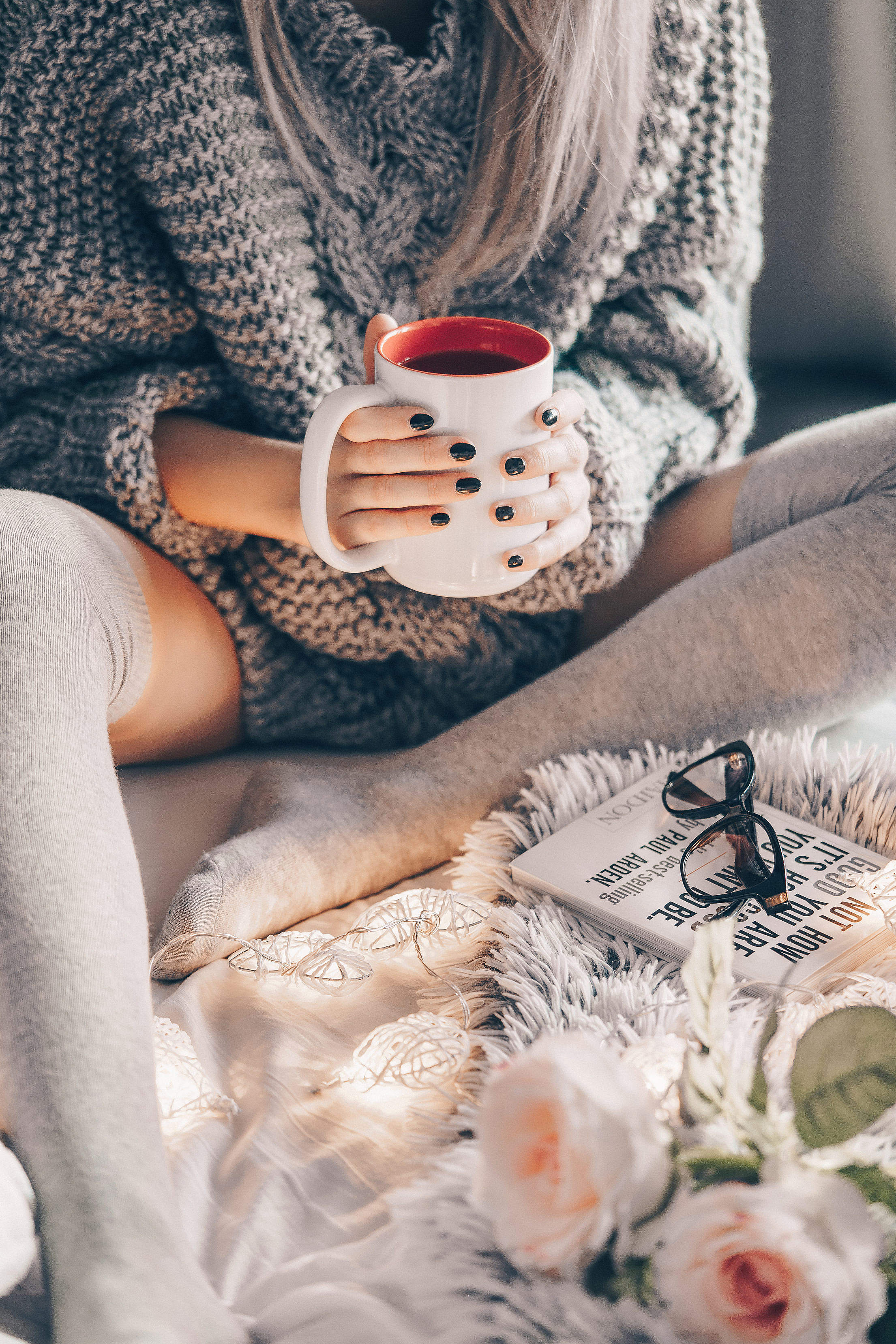 Woman Wearing Knitted Sweater Relaxing in Bed Free Stock Photo
