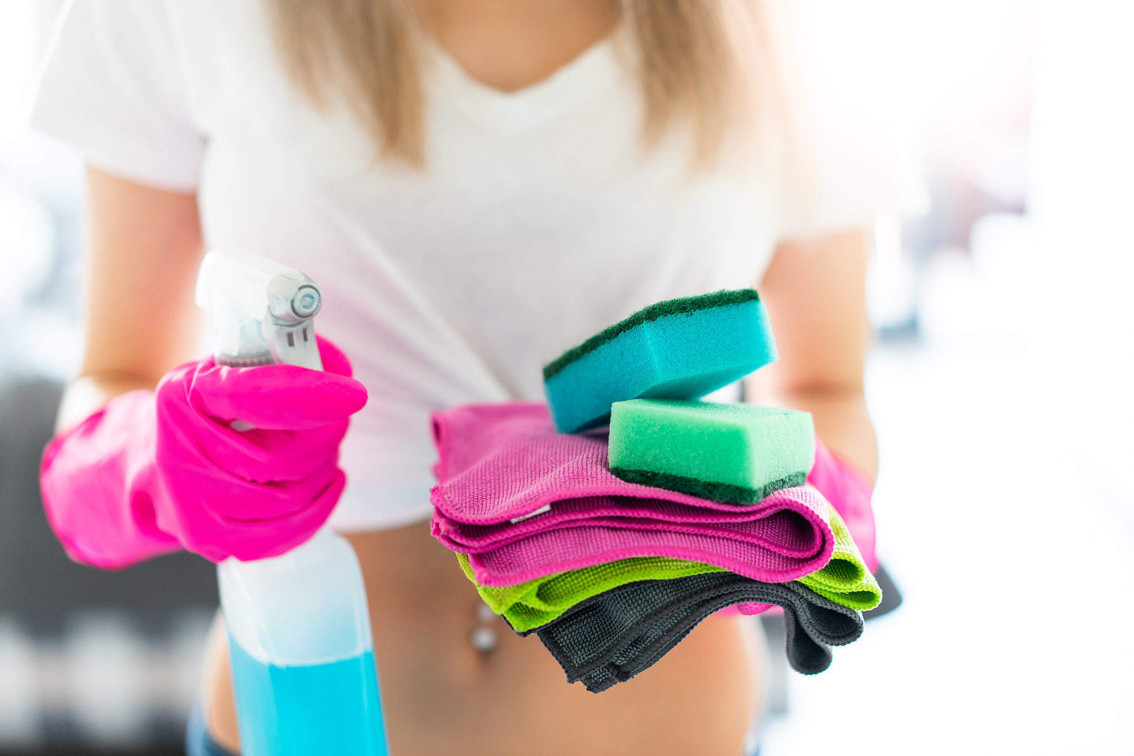 Woman Wearing Rubber Protective Gloves and Holding Spray Detergent and Rags Free Stock Photo