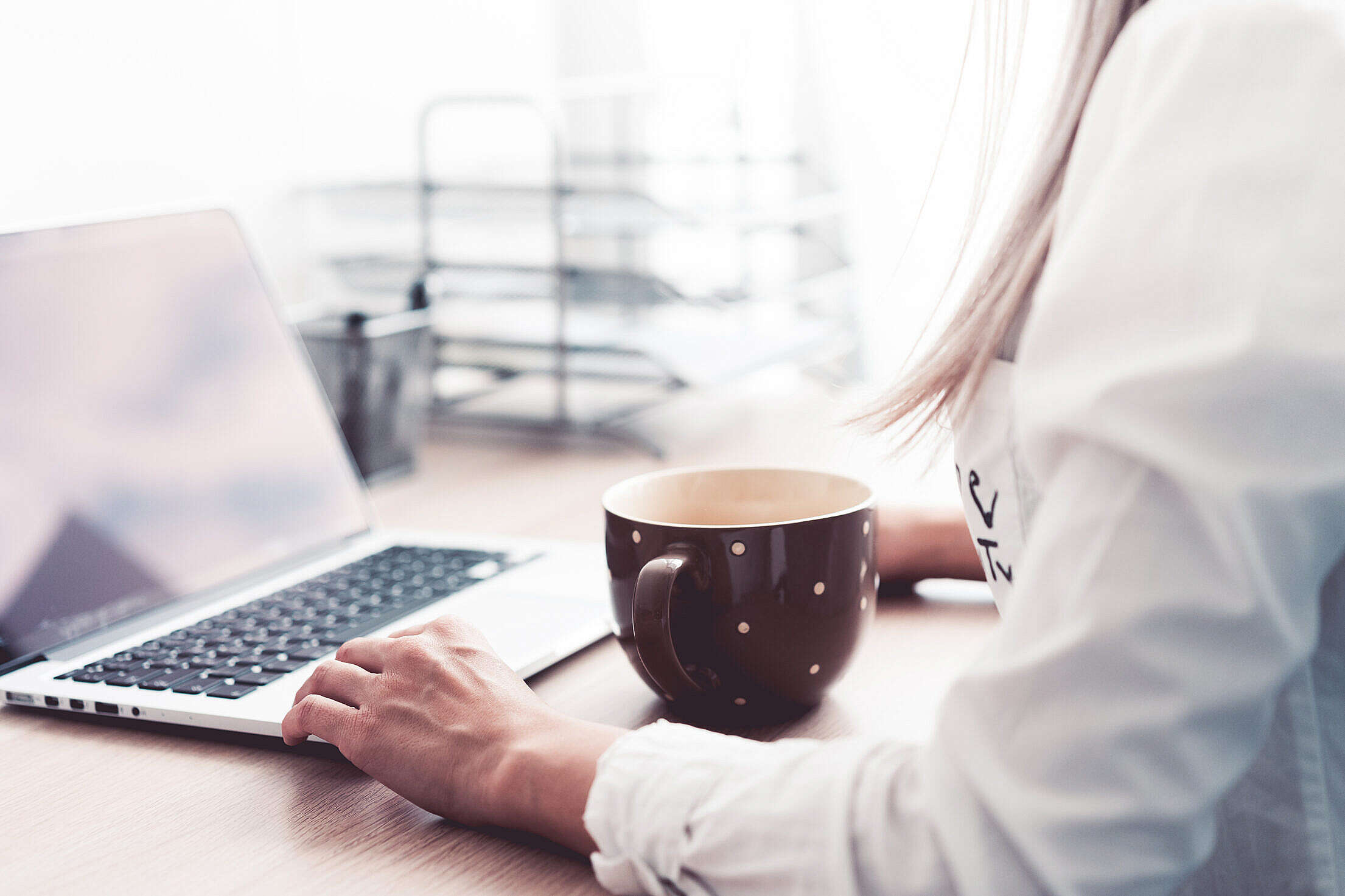 Woman Working and Drinking Tea in The Office Free Stock Photo