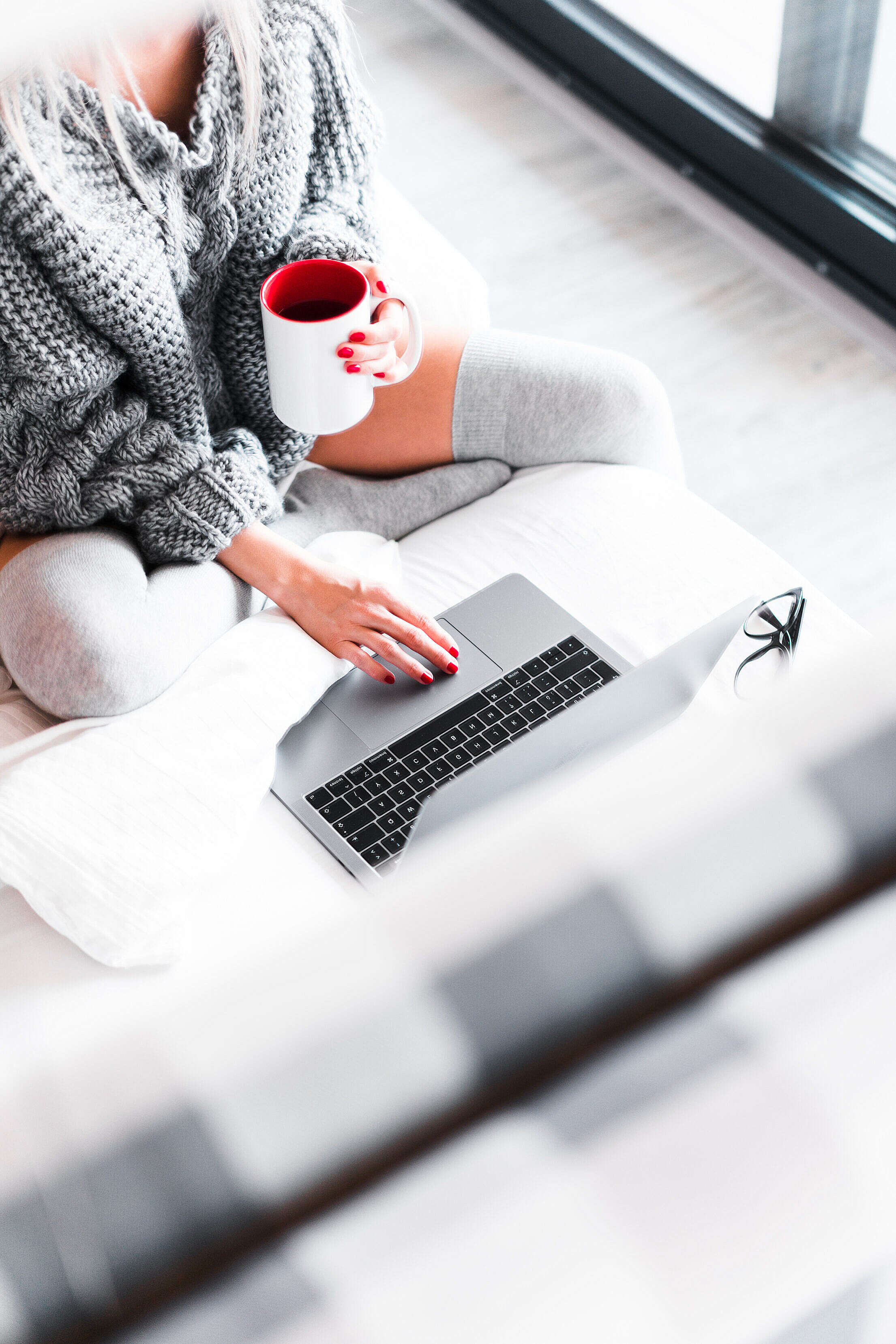 Woman Working from Her Bed with Laptop Free Stock Photo