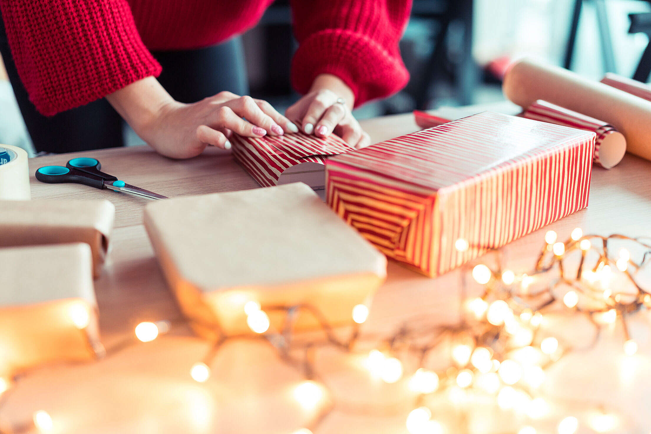Woman Wrapping Christmas Gifts Free Stock Photo