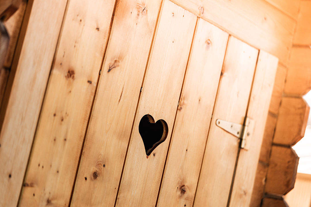 Download Wooden Outdoor Toilet with a Carved Heart in The Door FREE Stock Photo