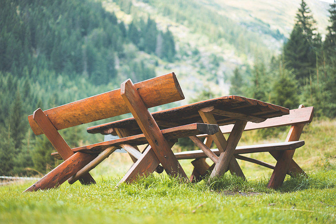 Download Wooden Picnic Seating Area in the Middle of Mountains FREE Stock Photo