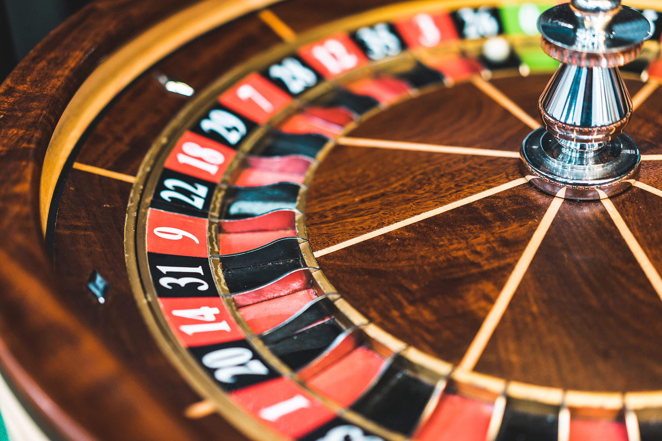 Wooden Roulette Wheel Casino Game Close Up Free Stock Photo