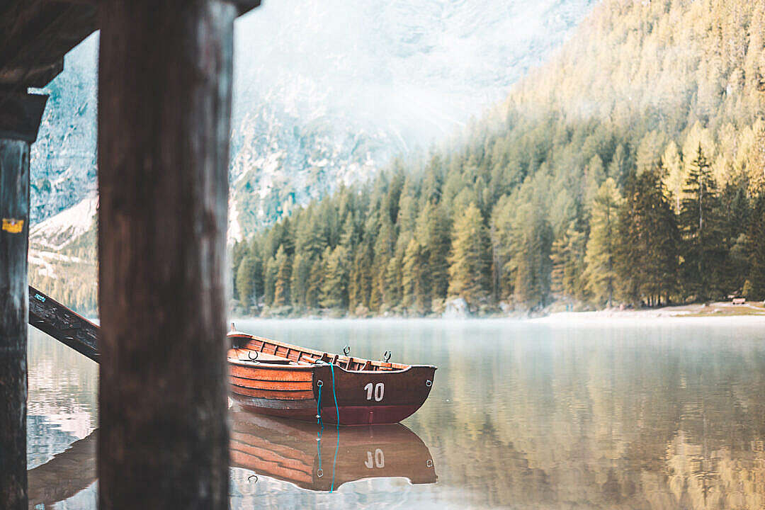 Download Wooden Rowing Boat on a Lake in the Morning FREE Stock Photo