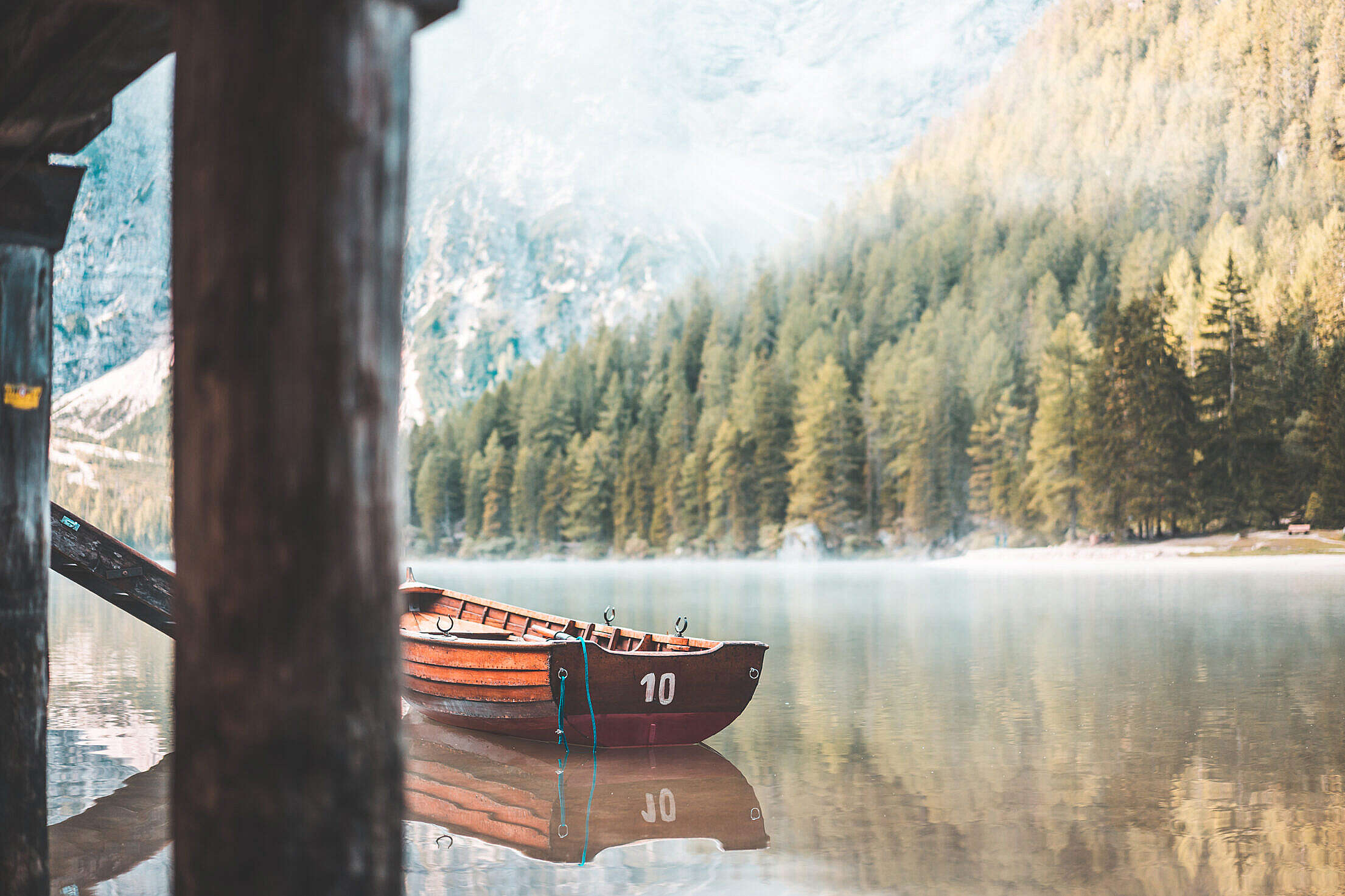 Wooden Rowing Boat on a Lake in the Morning Free Stock Photo
