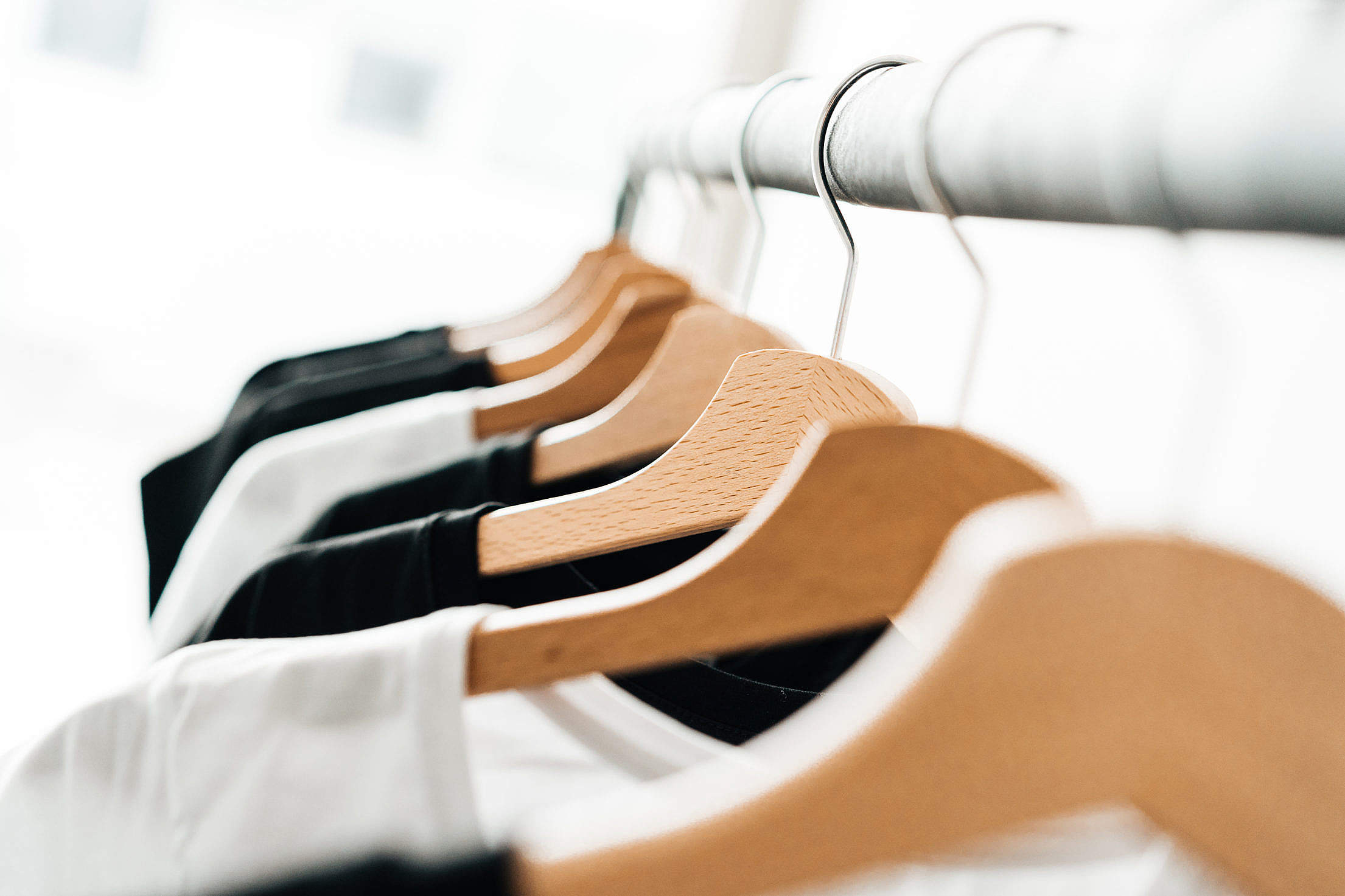 Download Wooden T-Shirt Hangers in Fashion Apparel Store Free Stock Photo
