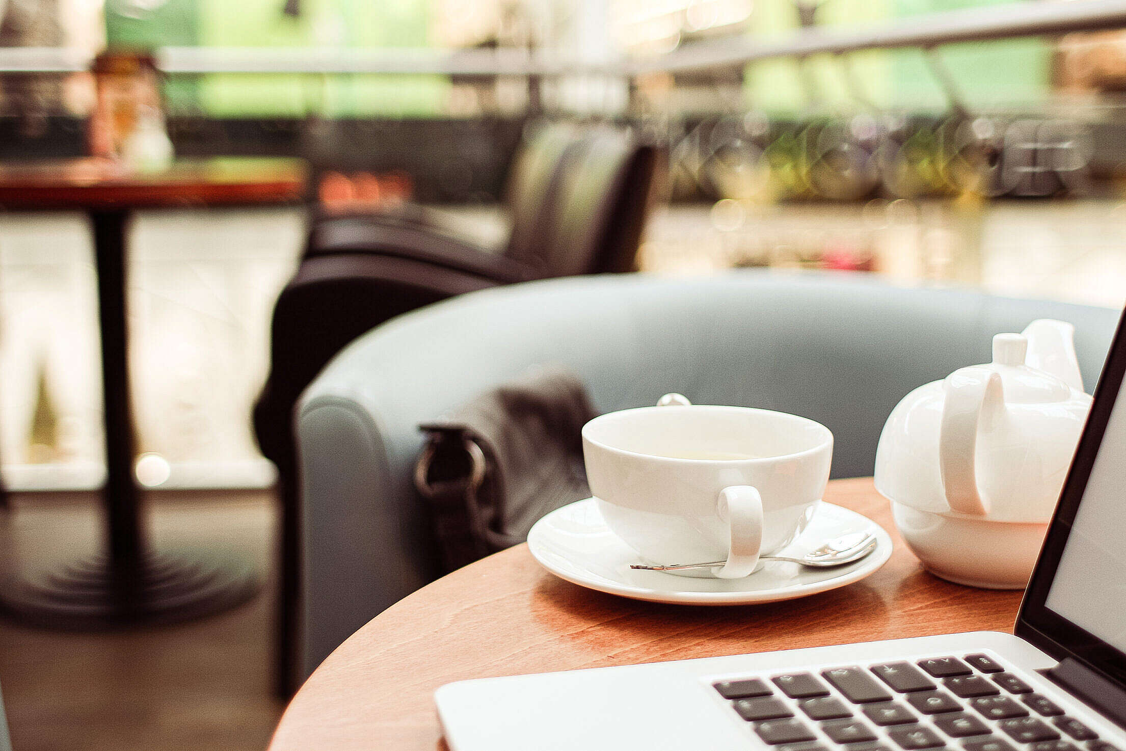 Working Remotely from a Cafe Free Stock Photo