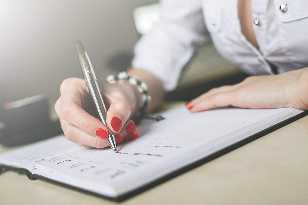 Download Writing in a Diary Close-Up FREE Stock Photo
