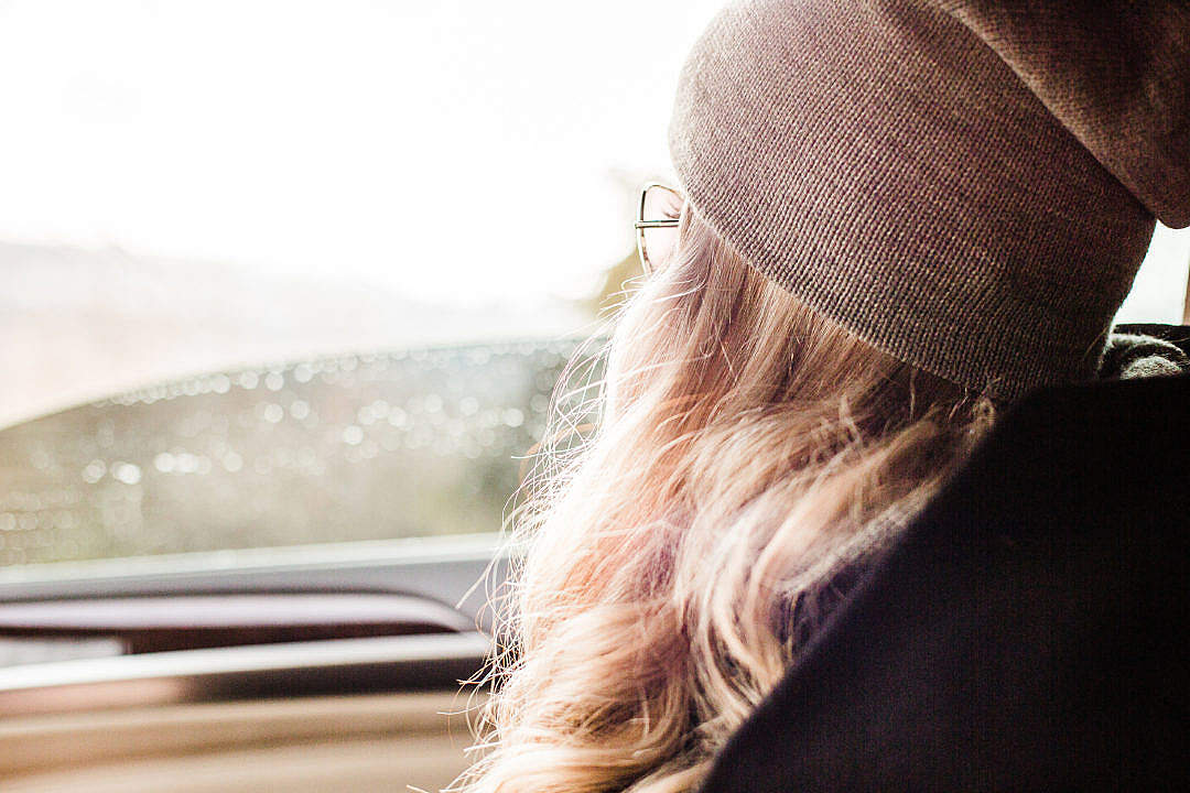 Download Young & Beautiful Blonde Girl Looking Out of Car Window FREE Stock Photo
