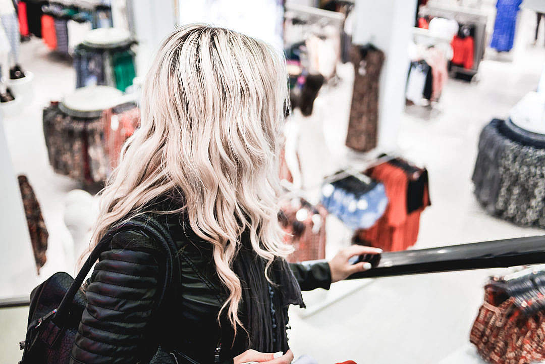 Download Young Blonde Girl Shopping at the Clothing Store FREE Stock Photo