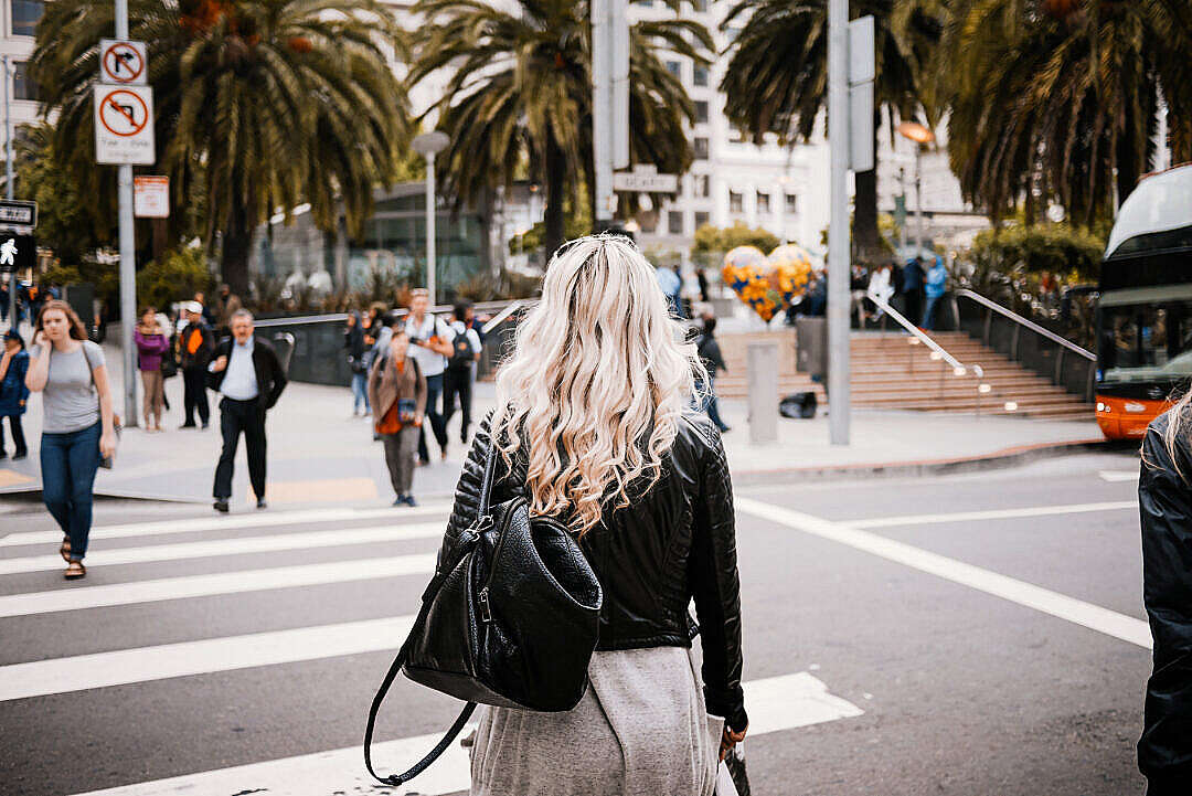 Download Young Blonde Walking Towards Union Square in SF FREE Stock Photo