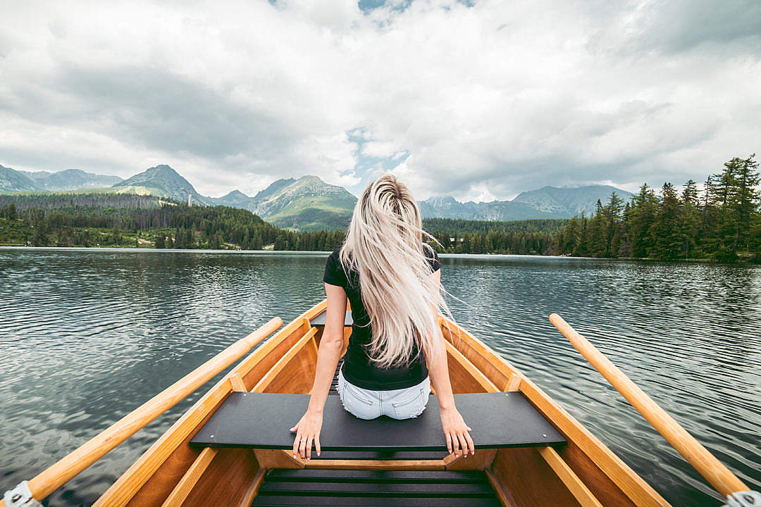 Download Young Blonde Woman Enjoying a Rowing Boat FREE Stock Photo