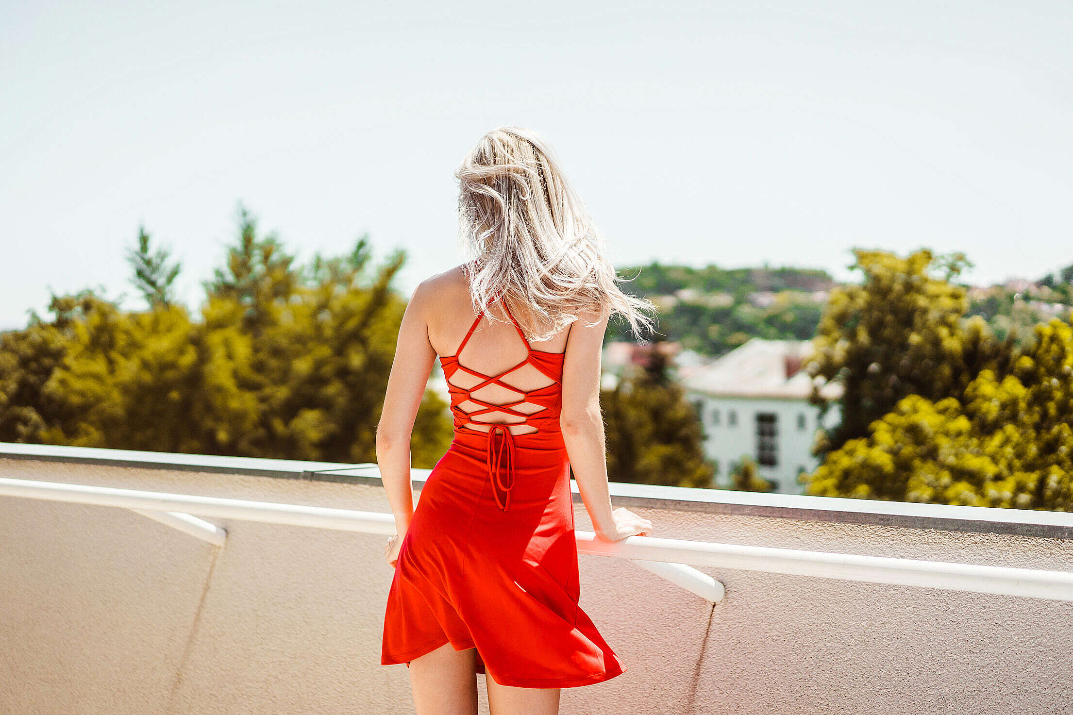 Young Blonde Woman Looking Around on Terrace Free Stock Photo