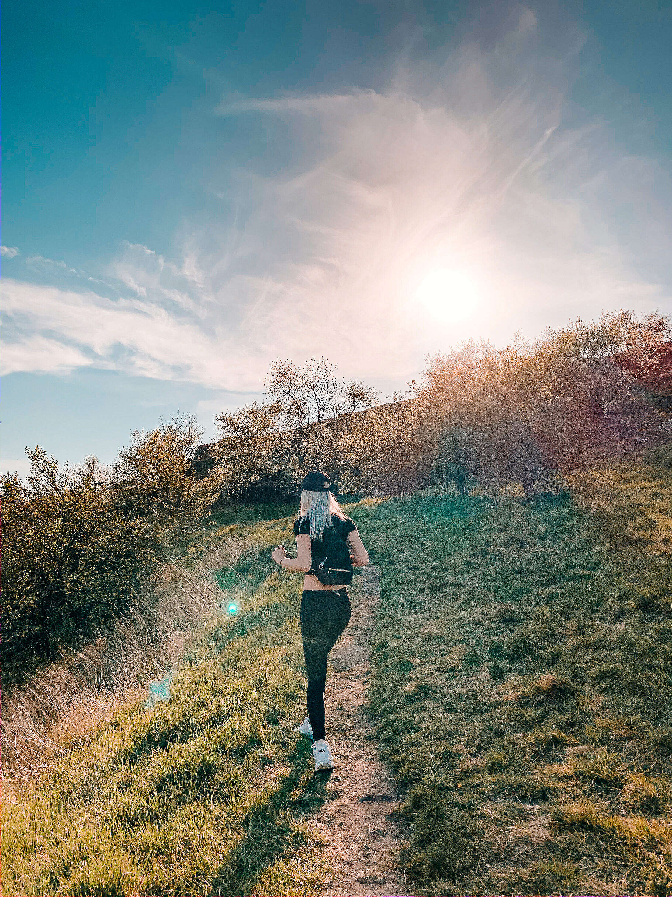 Young Blonde Woman On a Walk in Nature Free Stock Photo