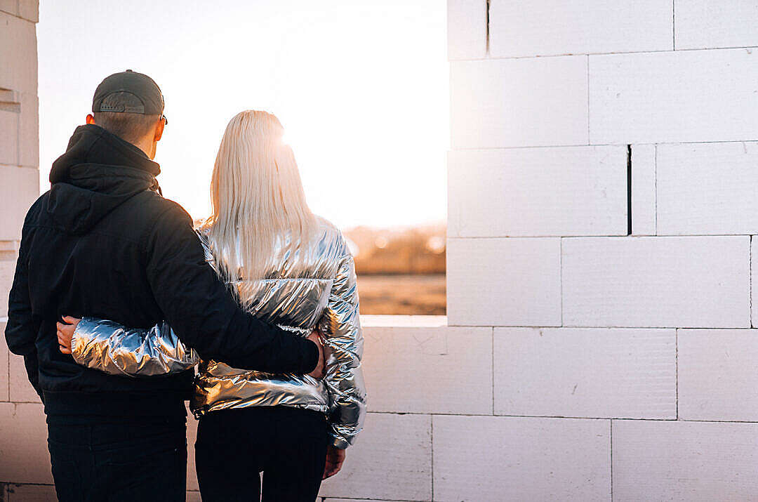 Download Young Couple Looking Out of The Future Window FREE Stock Photo
