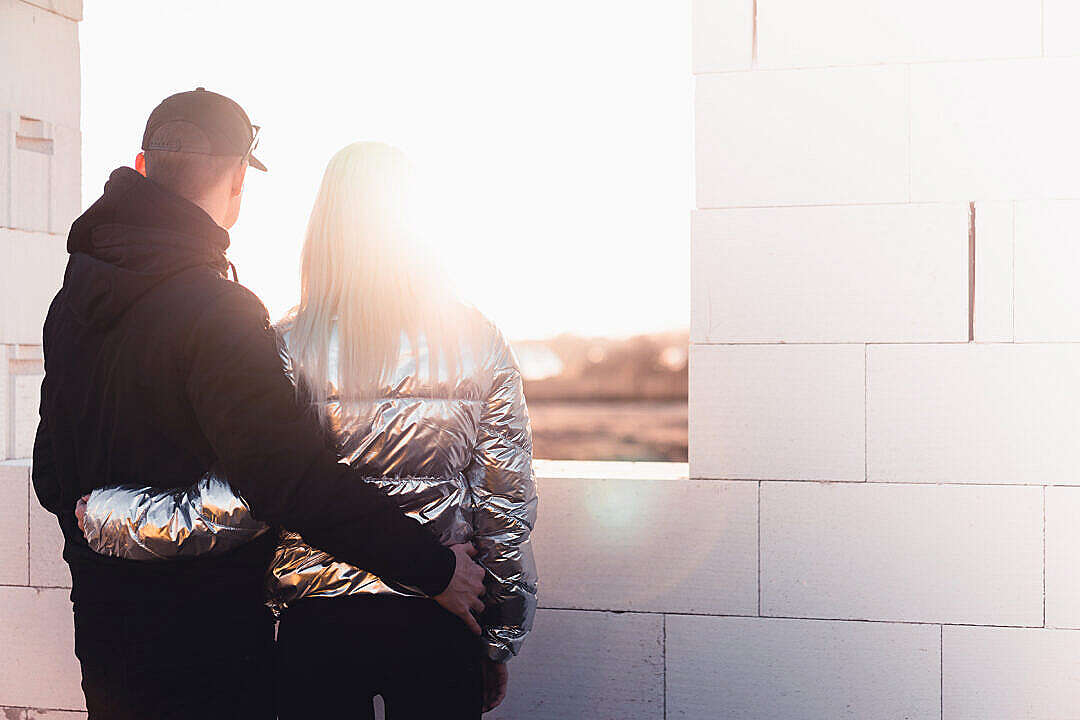 Download Young Couple Standing on The Construction Site of Their New House FREE Stock Photo