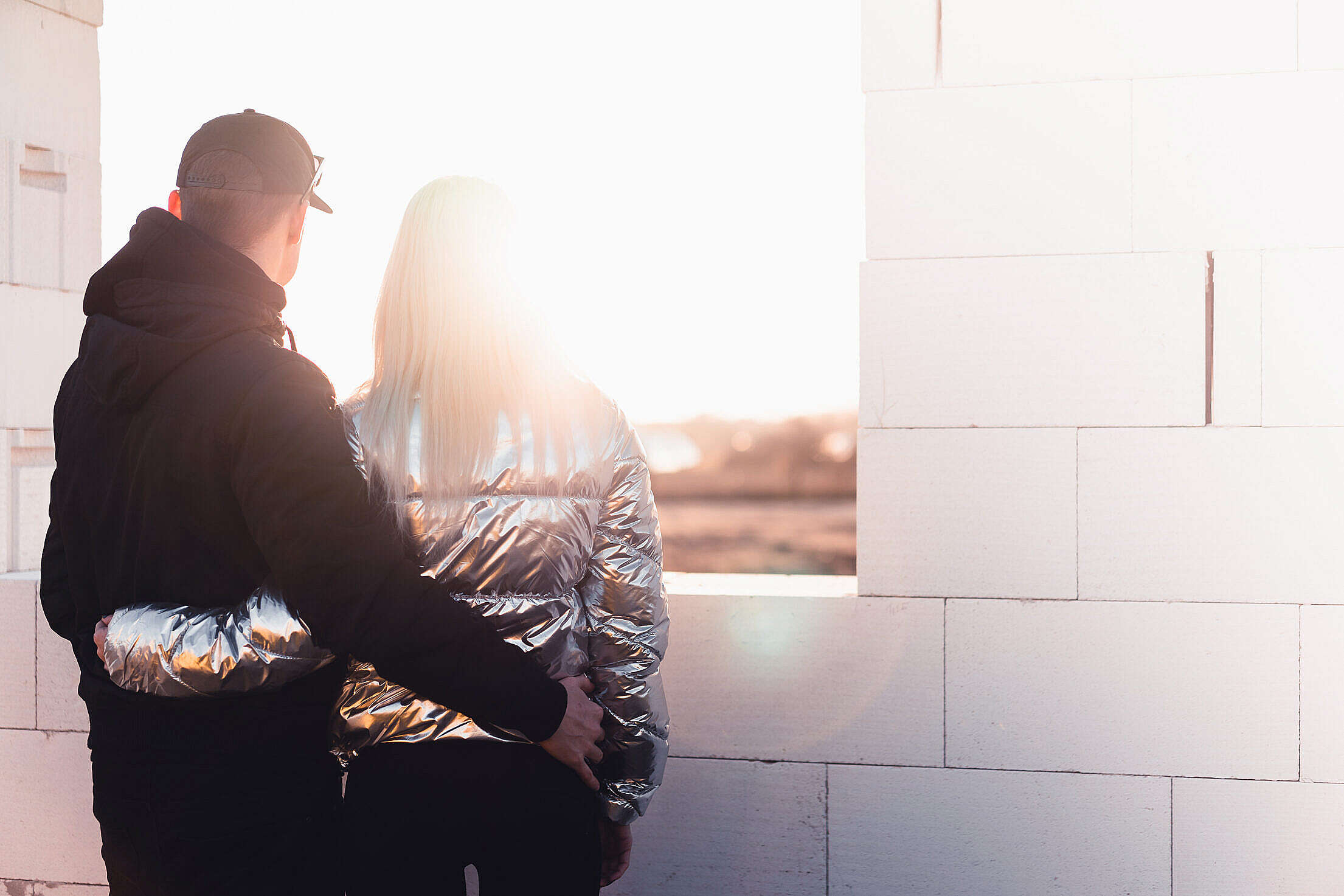 Young Couple Standing on The Construction Site of Their New House Free Stock Photo
