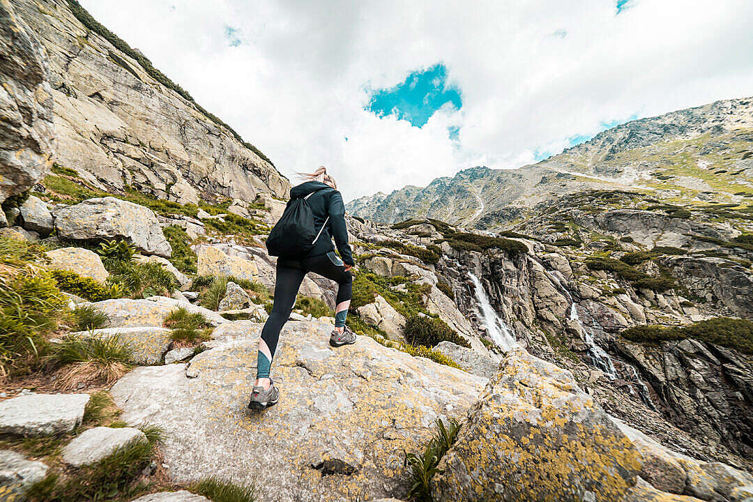 Download Young Fit Woman Hiking to the Waterfall Mountain FREE Stock Photo